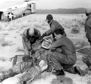 The ground crew assists Capt. Kittinger in removing his flight gear after the successful flight of Excelsior III. (U.S. Air Force photo)