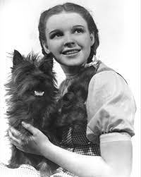 "Judy Garland as ""Dorothy"" with her dog, ""Toto"""